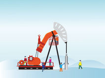 Oil pump with oil worker. Royalty Free Stock Photos