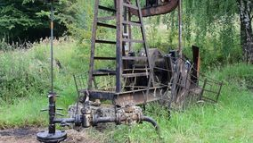Oil pump in operation in the forest area stock video