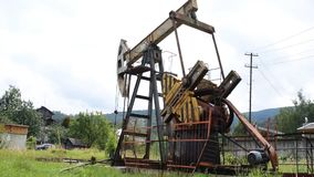 Oil pump in operation in the forest area stock footage