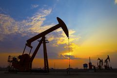 Oil Pump on orange sunset Stock Images