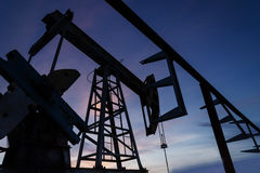 Oil pump and pipeline silhouette Stock Photos