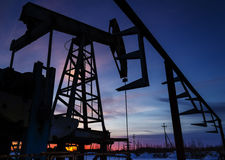 Oil pump and pipeline silhouette Stock Photography
