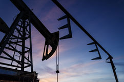 Oil pump and pipeline silhouette Royalty Free Stock Photos