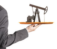 Oil pump on the plate in hand Stock Images