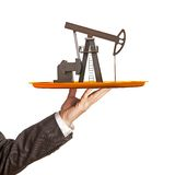 Oil pump on the plate in hand Stock Photo