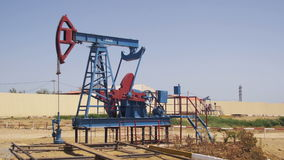 Oil Pump, Pump jack. Fossil Fuel Energy, Old Pumping Unit stock video footage