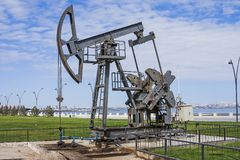 Oil pump pumping oil in former oil fields. Equipment of the oil industry. Azerbaijan,. Oil pump pumping oil in former oil fields. Equipment of the oil industry royalty free stock photo