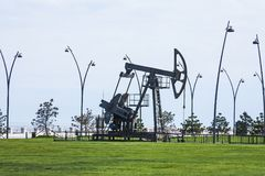 Oil pump pumping oil in former oil fields. Equipment of the oil industry. Azerbaijan,. Oil pump pumping oil in former oil fields. Equipment of the oil industry stock photos
