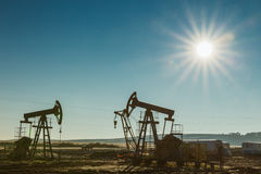 Oil pump rig energy industrial machine for petroleum. Blue sky Royalty Free Stock Photo