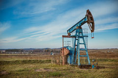 Oil pump rig energy industrial machine for petroleum. Blue sky royalty free stock photography