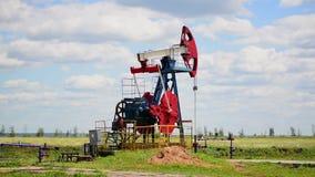 Oil pump in a rye field stock video footage