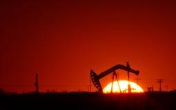Oil pump in Saskatchewan field. At sunset Stock Photography