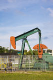 Oil Pump at Seria, Brunei. Image of an oil pump at Seria, Brunei Stock Photo