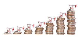 Oil pump and stack of coins . Stock Photography