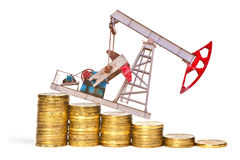 Oil pump and stack of coins Stock Image