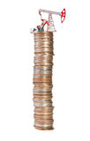 Oil pump and stack of coins Royalty Free Stock Image