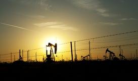 Oil pump sun set Stock Photography