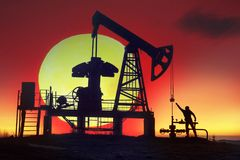 Oil pump at sunrise. In the Ukrainian Carpathians, the classical technology of oil and gas extraction by electric pumps against the background of the eternal Royalty Free Stock Image
