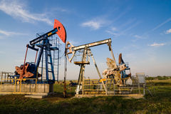 Oil pump at sunset Stock Photos