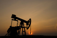 Oil pump at sunset Stock Photography