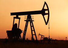 Oil pump at sunset Royalty Free Stock Photography