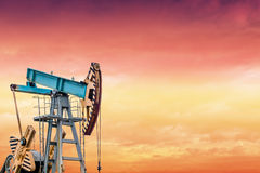 Oil pump at sunset. Royalty Free Stock Image