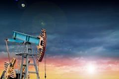 Oil pump at sunset. Royalty Free Stock Photos