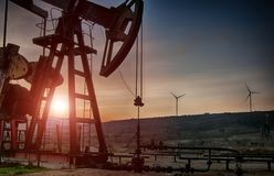 Oil pump on sunset. Oil pump on orange sunset Stock Photography