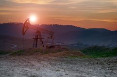 Oil pump on sunset Stock Photography