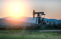 Oil pump on sunset Stock Photos