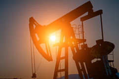 Oil pump on sunset Royalty Free Stock Images