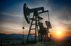 Oil pump on sunset Royalty Free Stock Photo