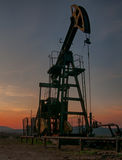 Oil pump on sunset Stock Photo