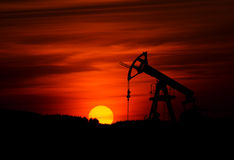 Oil pump and sunset Stock Photo