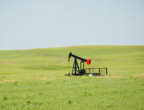 Oil pump on wide open prairie Stock Image