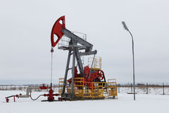 Oil pump in winter stock photos