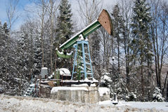 Oil pump in winter forest Stock Photo