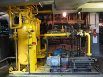Oil pump, yellow pipes, tubes, machinery at power plant. Oil pump, yellow pipes, tubes, machinery at electric power plant royalty free stock photo