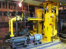 Oil pump, yellow pipes, tubes, machinery at power plant. Oil pump, yellow pipes, tubes, machinery at electric power plant royalty free stock photos
