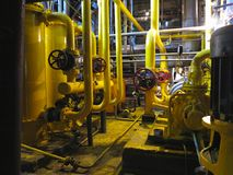 Oil pump, yellow pipes, tubes, machinery at power plant. Oil pump, yellow pipes, tubes, machinery at electric power plant stock photography