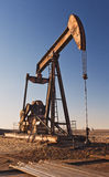 Oil Pumper. An oil pumper at Sunset on the plains of West Texas, USA Royalty Free Stock Photo