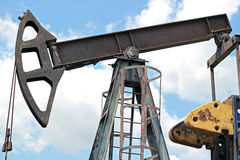 Oil Pumping. Pump jack against blue sky Stock Photography