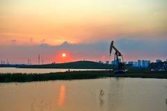 Oil pumping machine lakeside Royalty Free Stock Photos