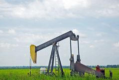 Oil Pumping Unit. To force oil through the ground Royalty Free Stock Photo