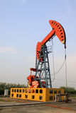 Oil pumping unit in working Royalty Free Stock Image