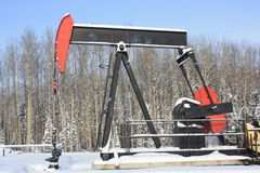 Oil pumpjack. A working oil pumpjack in Alberta's oilfield Royalty Free Stock Photography
