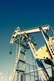 Oil pumpjack, industrial equipment. Rocking machines for power generation. Extraction of oil. stock photography