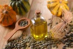 Oil pumpkin seed. Pumpkin seed oil in glass bottle Stock Photography