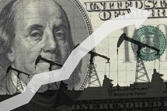 Oil pumps on the background of 100 dollars. Oil industry concept. Raising prices chart stock photo