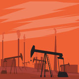 Oil pumps in the field. Landscape with sunset. Oil pumps in the field. Pump oil. Landscape with sunset Royalty Free Stock Image